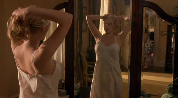 Katey Miller in front of a mirror